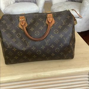 Louis Vuitton is Authentic purse $ 375
